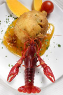 Artichoke from Tudela stuffed by freshwater crayfish with reineta sauce with Piquillo Peppers coulis